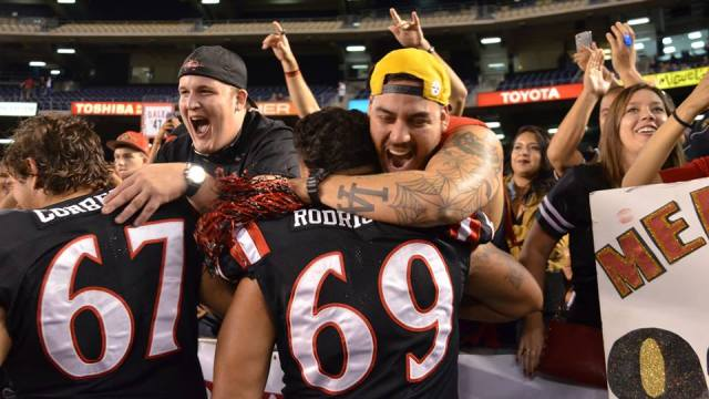 Junior offensive lineman Paul Rodriguez and senior offensive lineman Garret Corbett celebrate with fans after defeating the University of Idaho 35-21 on Saturday night. Courtesy of GoAztecs Facebook.