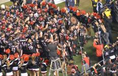 The San Diego State football team celebrate their win over Air Force in front of the SDSU student section. Courtesy of GoAztecs Facebook.