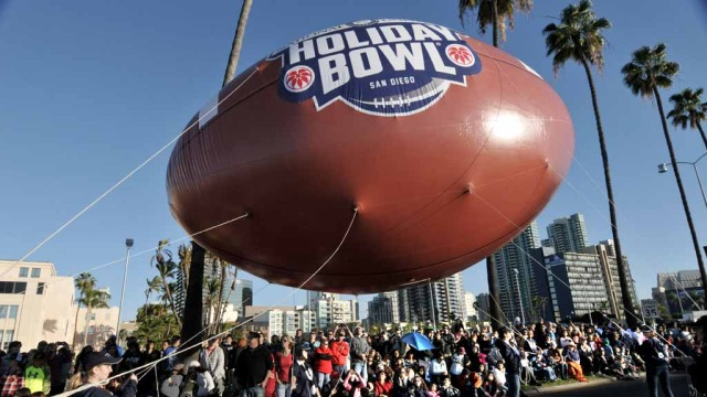 National University Holiday Bowl football promoted Saturday's game between USC and Nebraska.