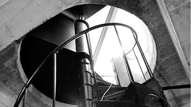 The spiral stairway to the first viewing platform of the California Tower. Black & white photo by Joe Nalven