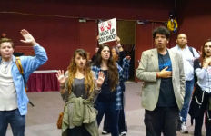 Protesters at Golden Hall after the inauguration ceremony. Photo by Chris Jennewein