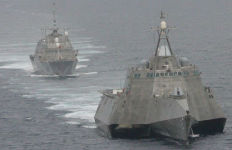 The single-hull USS Freedom (rear) and trimaran USS Independence maneuvering off San Diego. Navy photo