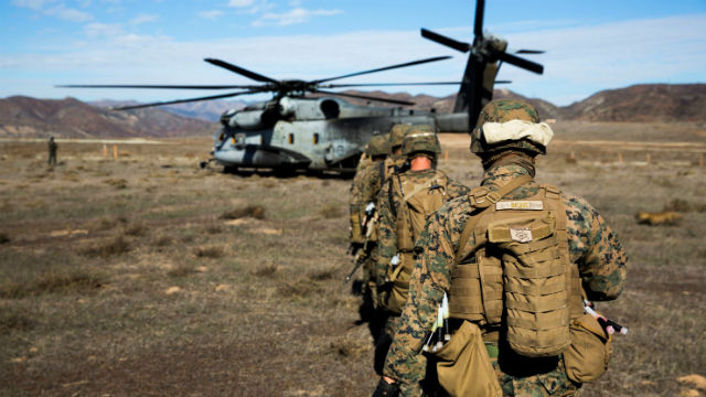 Marines from the 15th Marine Expeditionary Unit load onto a CH-53 helicopter at Camp Pendleton. Courtesy Marine Corps