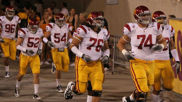 The USC Trojans enter a college football game. Photo via Wikimedia Commons