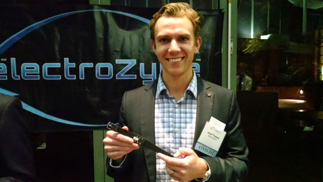 Jared Tangnew, co-founder of electroZyme, holds the company's personal hydration monitor. Photo by Chris Jennewein