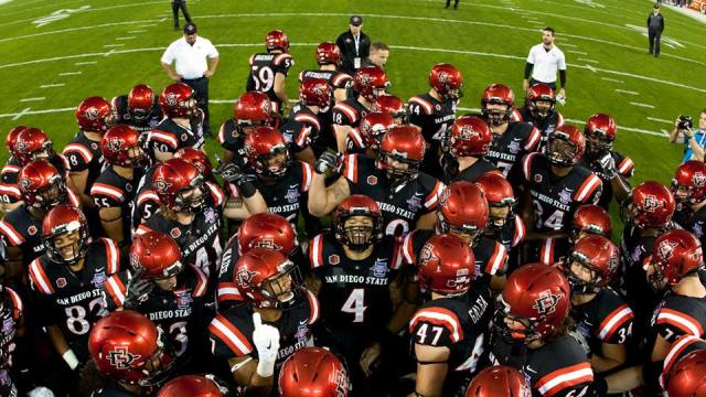 SDSU football players prepare for their match against Navy in the Poinsettia Bowl. Courtesy of Go Aztecs Facebook.