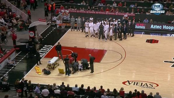 Paramedics tend to SDSU senior forward Dwayne Polee after he collapsed on the court. Courtesy of NBC San Diego Twitter.