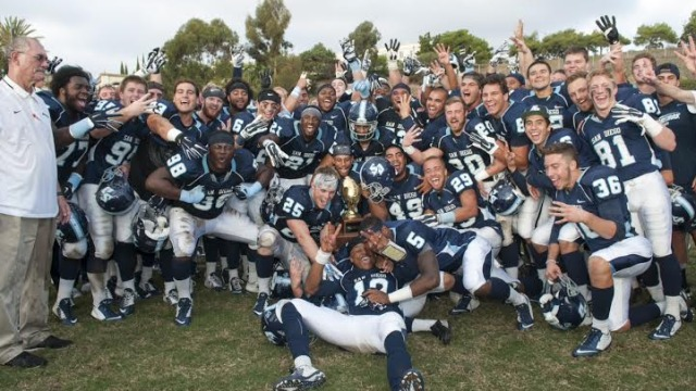 The USD football team celebrates their win against Valpariso on Nov. 15, to win the Pioneer Football League Championship. Photo credit: Brock Scott.