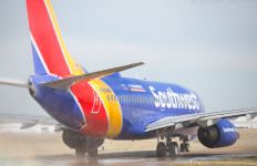 A Southwest Airlines jet on a runway. Photo credit: Stephen M. Keller/Southwest Airlines