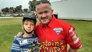 Monster truck star Alex Blackwell with a Toler Elementary student. Photo by Chris Jennewein