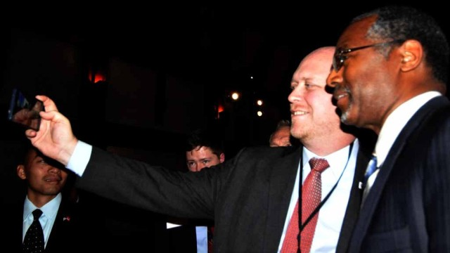 Tony Krvaric, chairman of the San Diego County Republican Party, takes a selfie with Ben Carson.