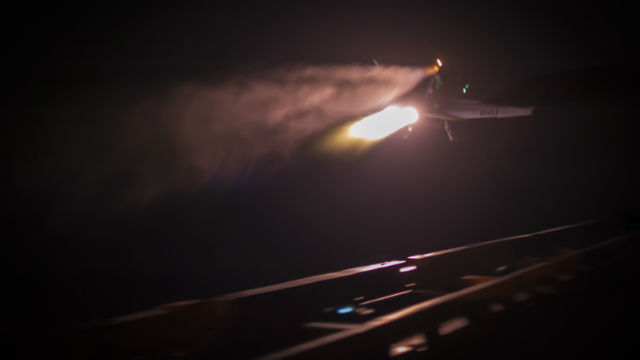 An F/A-18E Super Hornet from Strike Fighter Squadron 81 makes the final launch of 2014 from the flight deck of aircraft carrier USS Carl Vinson in the Arabian Sea. Navy photo by John Philip Wagner Jr.