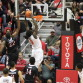 SDSU junior center Angelo Chol dunks the ball over a Fresno St. defender. Photo by Mike Hennessy.