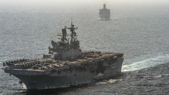 The amphibious assault ship USS Makin Island and the amphibious dock landing ship USS Comstock in the Arabian Sea. Navy photo