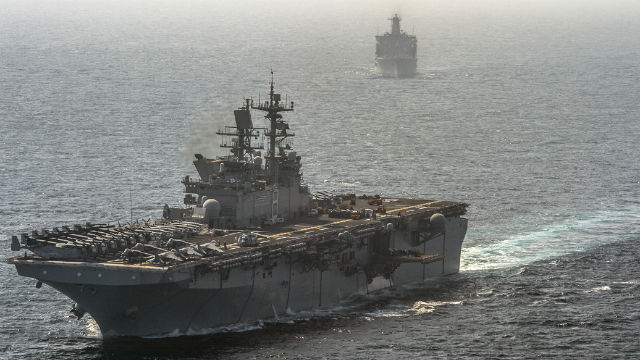 The amphibious assault ship USS Makin Island and the amphibious dock landing ship USS Comstock in the Arabian Sea. Navy photo