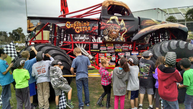 """Students from Toler Elementary crowd around the """"Captain's Curse."""" Photo by Chris Jennewein"""