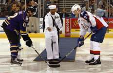 A Sailor drops the puck to start a Norfolk Admirals hockey game. Navy photo
