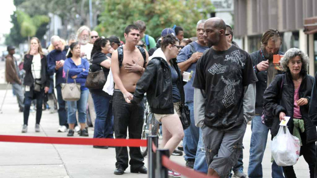Homeless lined up from Golden Hall to C street to get free assistance Wednesday.