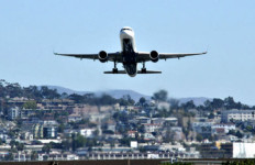 A passenger jet takes off from San Diego International Airport. Photo by Chris Stone