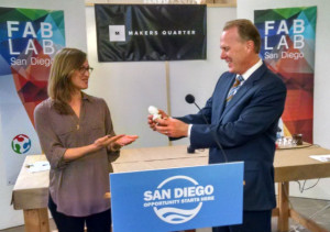 Katie Rast of Fab Lab San Diego presents Mayor Kevin Faulconer with a 3-D printed likeness. Photo by Chris Jennewein