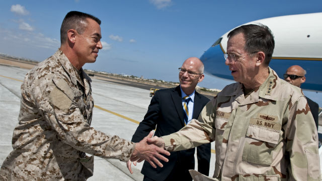 Rear Admiral Brian Losey (left) greets Admiral Mike Mullen, former chairman of the Joint Chiefs of Staff, in Djibouti. Defense Department photo
