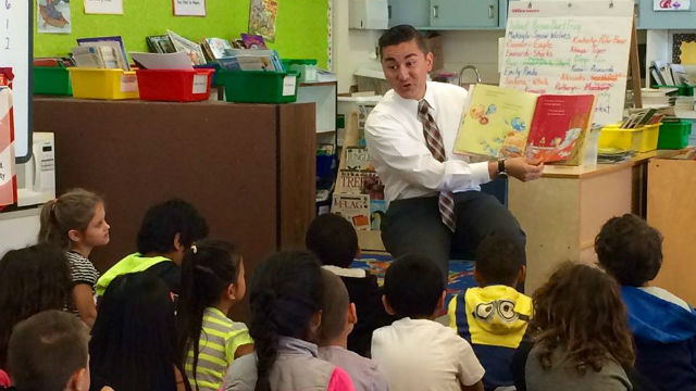 San Diego City Council member Chris Cate reads to first grade students at LaFayette Elementary in Clairemont. Courtesy Words Alive