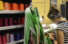 Seamstress Nathalie Martin readies a costume before opening night in San Diego of Cirque Du Soleil's Varekai.