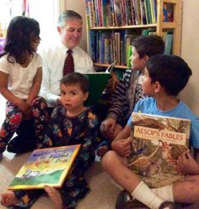 San Diego County Supervisor Dave Roberts reads with his family.