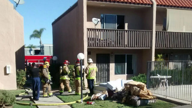Photo shows Heartland firefighters with debris taken from the condo.  Photo by Heartland Fire Marshal Chris Jensen
