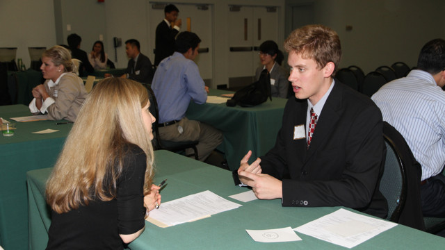 A hiring interview at a job fair. Photo via Wikimedia Commons