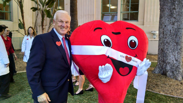 """San Diego County Supervisor Ron Roberts with the """"Love Your Heart"""" character. Photo by Chris Jennewein"""
