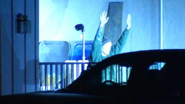 Man depicted as Mike Montana surrenders in El Cajon after SWAT response in Kyle Kraska shooting. Image via KUSI and Twitter.com