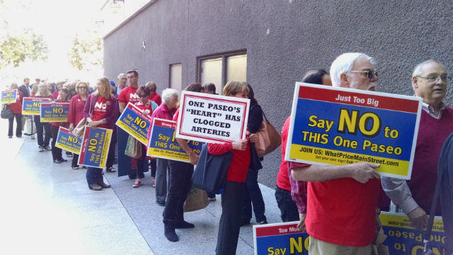 Opponents of the One Paseo project line up outside City Hall before Tuesday's City Council meeting. Photo by Chris Jennewein
