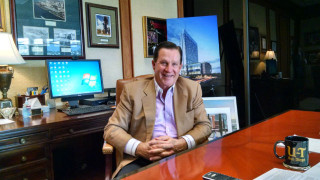 Papa Doug Manchester in his office at the U-T San Diego in Mission Valley. Photo by Chris Jennewein
