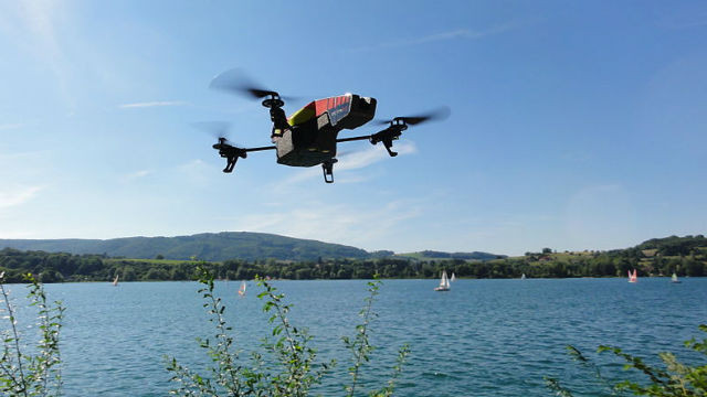 A French-made Parrot AR.Drone 2.0 flies over a lake. Photo by Nicolas Halftermeyer via Wikimedia Commons