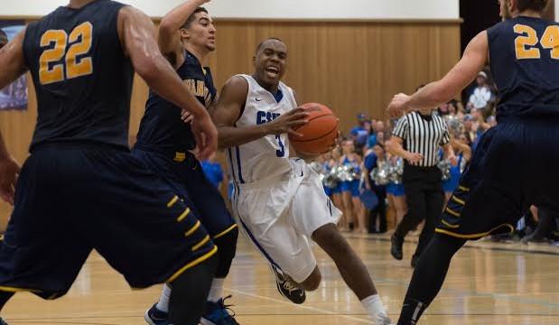 CSUSM junior guard Akachi Okugo drives to the basket. Photo credit: Bruce Sherwood.