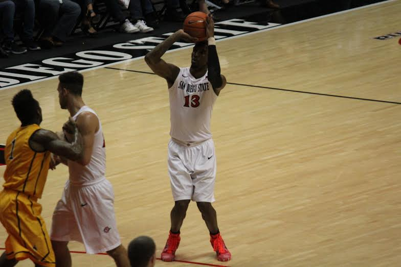SDSU junior guard Winston Shepard attempts a three. He went 2-3 from behind the arc against Wyoming. Photo by Mike Hennessy