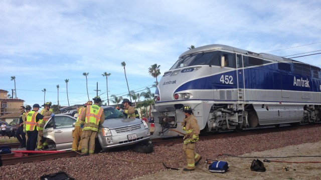 Firemen and police at the scene of the accident. Courtesy Oceanside Police Department