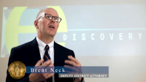 Deputy District Attorney Brent Neck describes eDiscovery system in video. Image via DANewsCenter.com