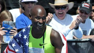 Bernard Lagat of Tucson receives a lot of attention from the crowd after the Elite Men's race in which he finished third.