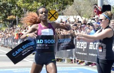 Despite sprinting down the finish hill on Carlsbad Village Drive, Genzebe Dibaba missed  the 5-kilometer world record by 2 seconds. Chris Stone photo