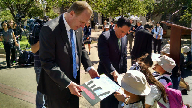 Mayor Kevin Faulconer (left) and City Councilman Todd Gloria examine children's artwork in Balboa Park. Photo by Chris Jennewein