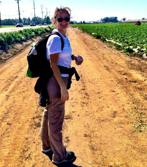 Maggie Espinosa hikes through strawberry fields in Oxnard.