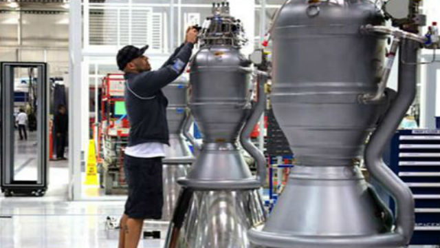 An employee works on a rocket engine at the SpaceX factory in Hawthorne. Courtesy SpaceX