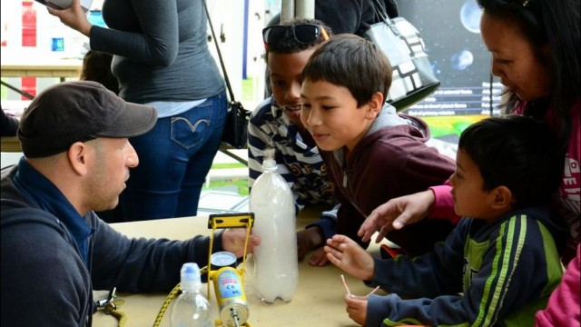 A volunteer shares the excitement of science at the 2014 festival. Courtesy San Diego Festival of Science and Engineering