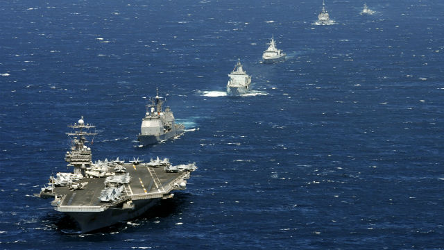 The USS Theodore Roosevelt leads a flotilla of warships. Navy photo