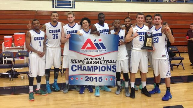 The Cal State San Marcos mens basketball team holds a banner to commemorate their second straight A>I.I. title. Courtesy of CSUSM Athletics Department.