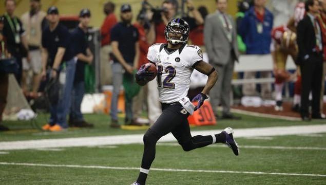 Jacoby Jones returns a kick for a touchdown. Courtesy of sportsworlddepot.com