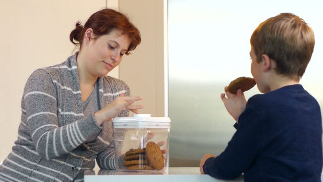 A mother locks cookies in a kSafe prototype.