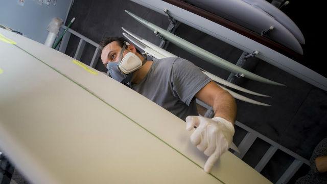 Shaping the algae surfboard created by UC San Diego.